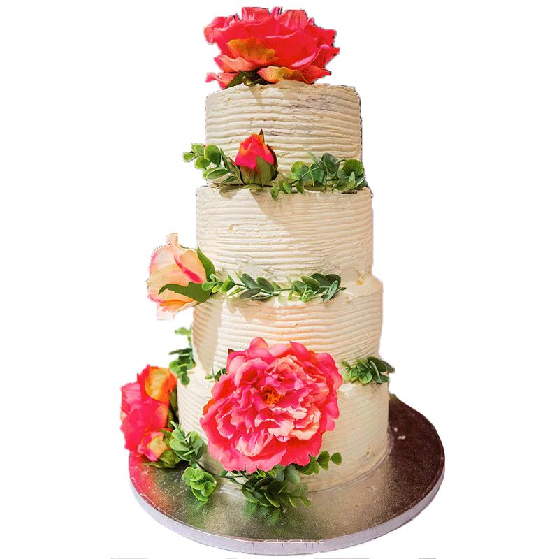 Gateau de mariage à 4 étages style naked cake, glaçage blanc ornementé de fleurs roses