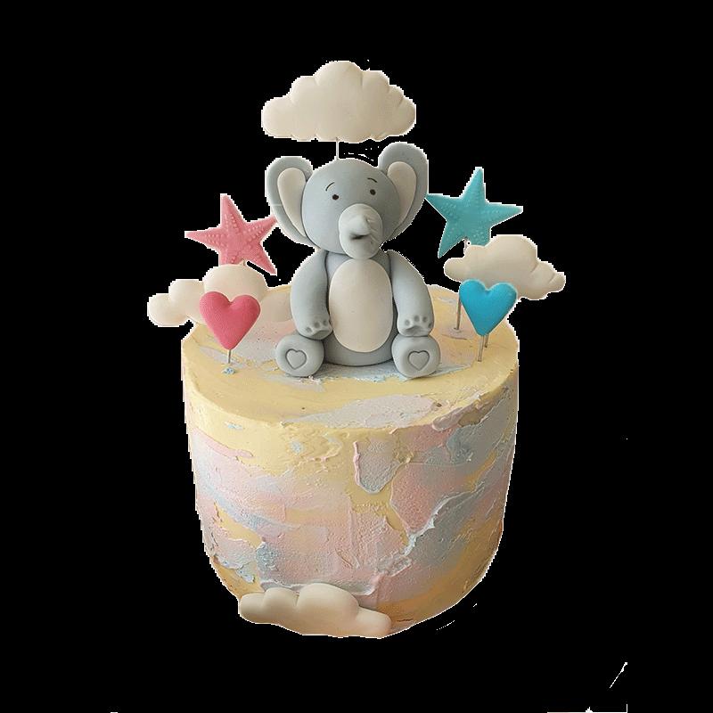 Gâteau pour révéler le sexe du bébé avec un éléphant, deux coeurs et deux étoiles bleu et rose